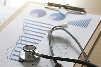 Graphs and charts along side a stethoscope